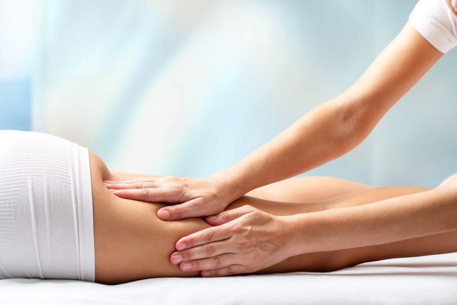 Woman receiving leg massage.